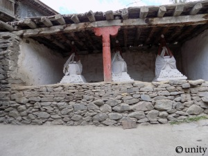 Three little stupas in the middle of the village